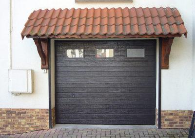 Porte de garage sectionnelle, laqué bronze