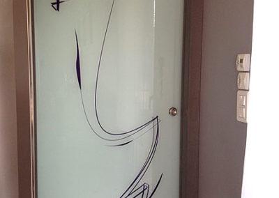 Porte intérieure coulissante en verre
